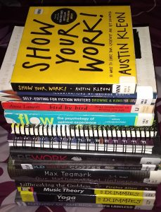 Picture of a stack of non-fiction books.